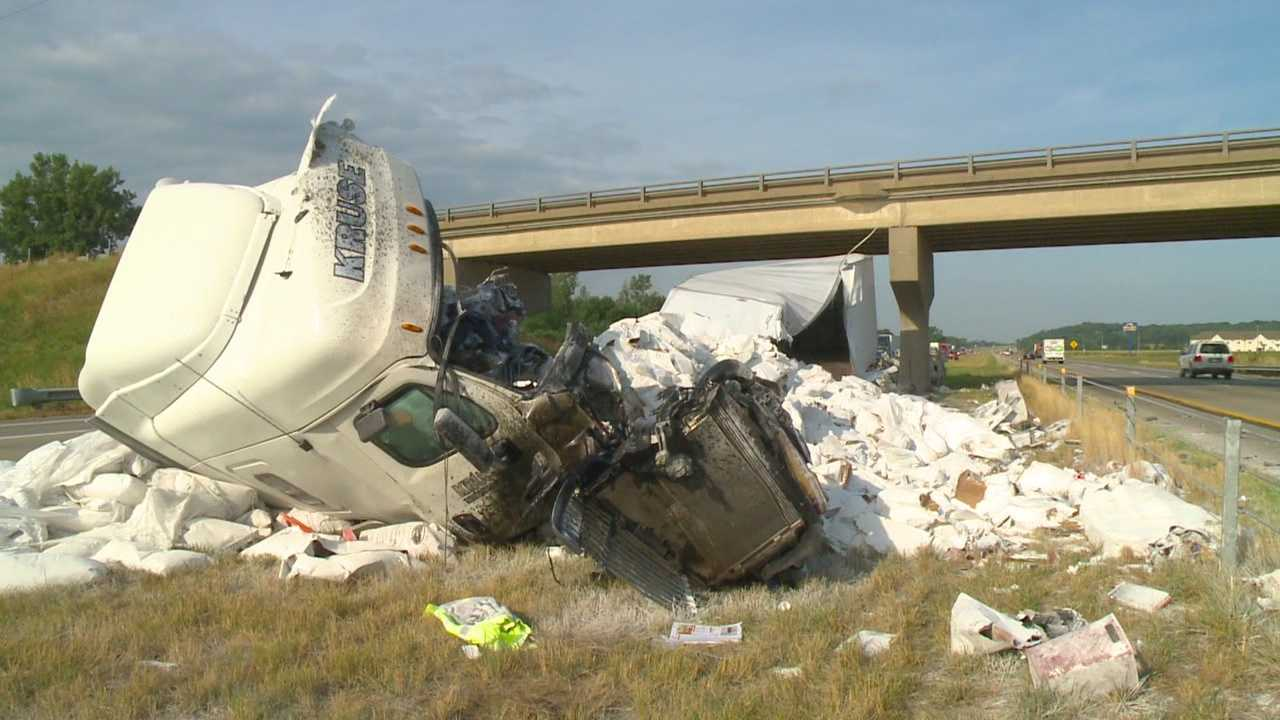 A semi broke into pieces after it slammed into an interstate bridge Friday.