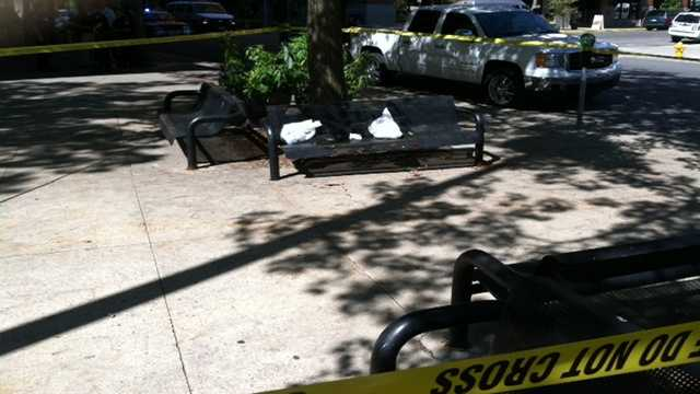 Man found with stab wounds on park bench.