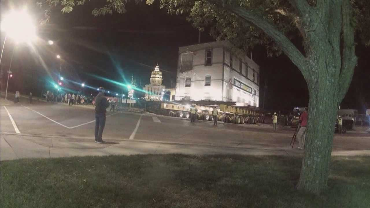 Dozens of people stayed up late to watch a Des Moines landmark move to a new location.