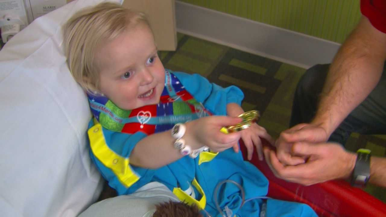 A special little patient at Mercy Hospital earned a marathon medal Sunday, even though he didn't cross the finish line.