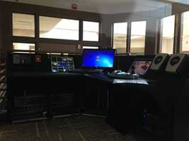 A control center outfitted with computers and other security monitoring equipment.