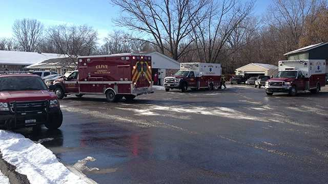 Ambulances evacuate residents after sprinkler pipe bursts.