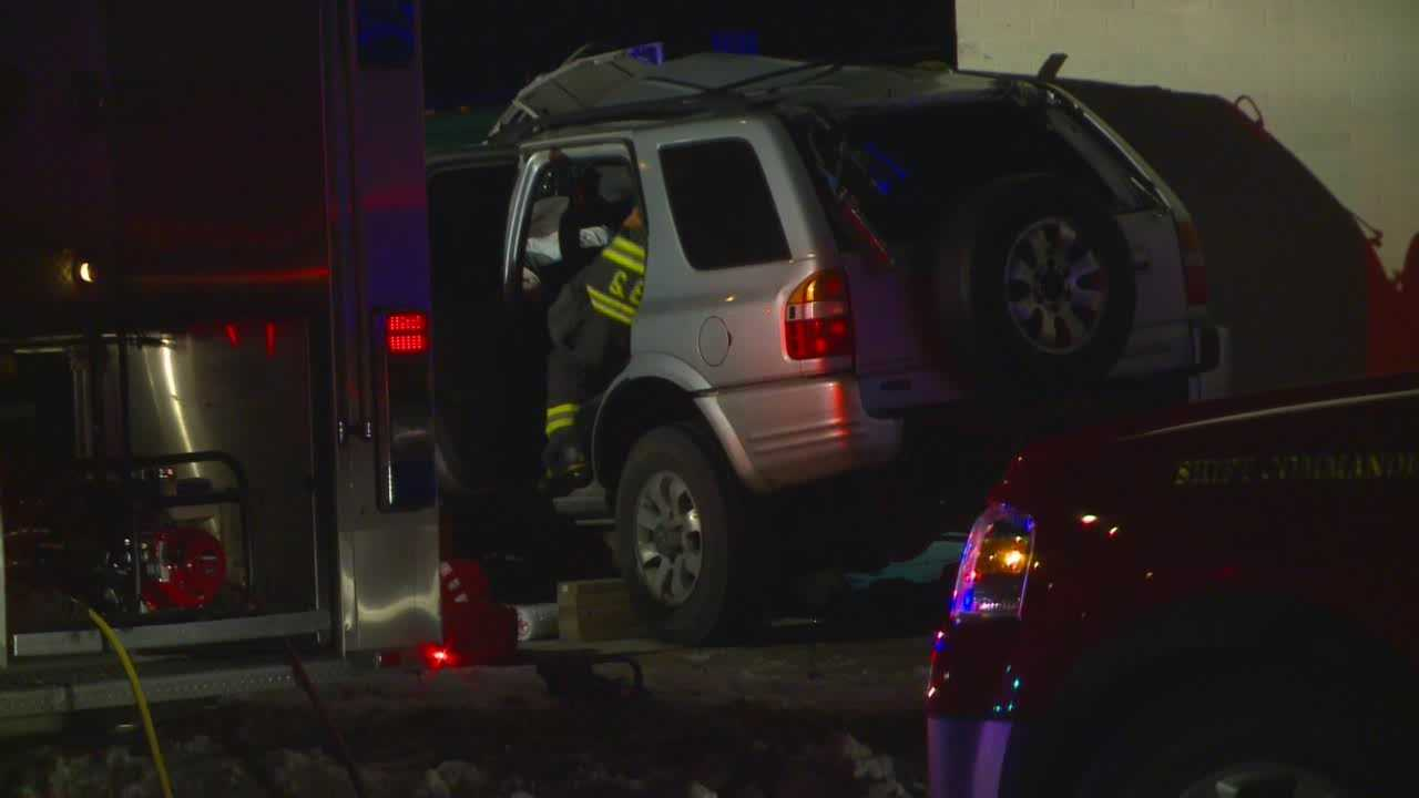 2 injured when SUV slams into building