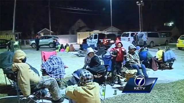 People camp outside a new Krispy Kreme store in Iowa to get a free doughnut deal.