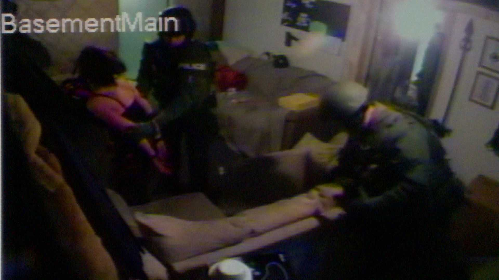 Freeze frame from the Prince family's basement surveillance camera