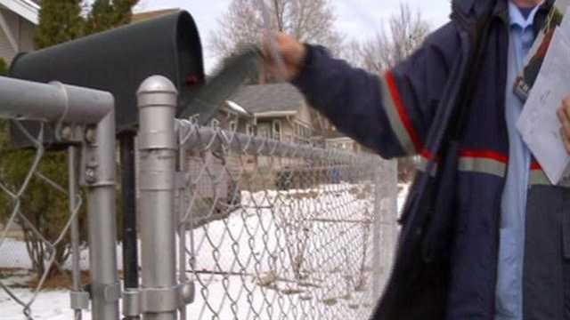 Postal worker delivering mail
