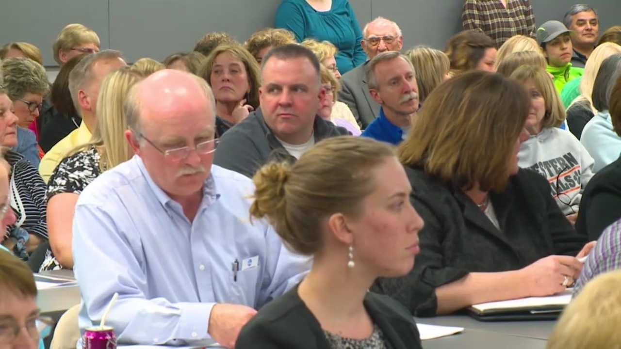 Parents plead for West Des Moines school board to avoid cuts