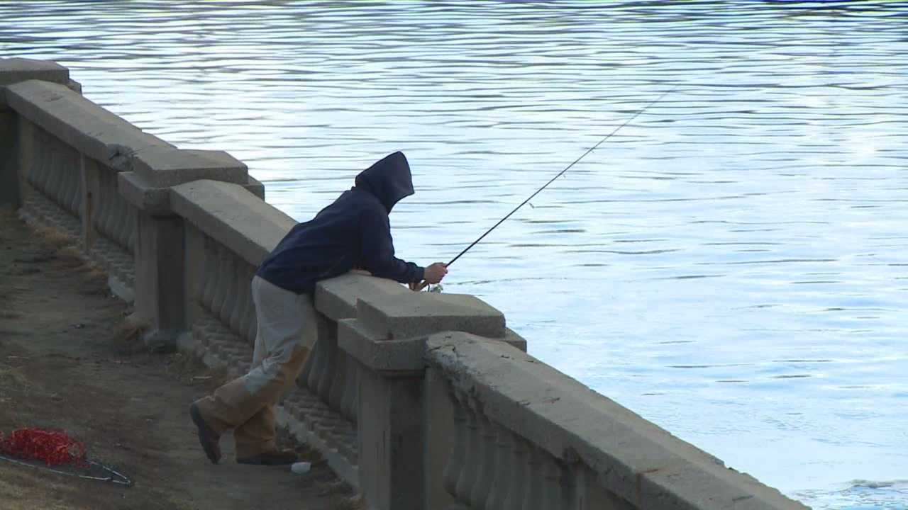 Fisherman on the new downtown Des Moines Riverwalk can stay where they are for now.