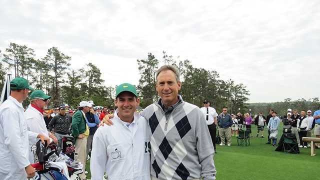 Nate and Mike McCoy pose on the first tee before beginning a practice round at Augusta National Golf Club.