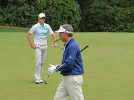 Iowans Mike McCoy (foreground) and Zach Johnson (striped shirt) on the 4th green at Augusta National Golf Club.