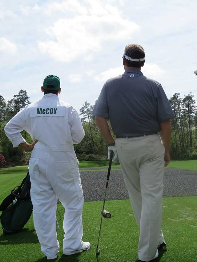 Mike McCoy and his son/caddy Nate McCoy sizing up the 12th green at Augusta National Golf Club.