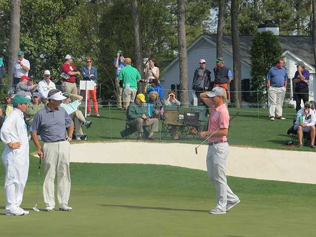 Mike McCoy and son/caddy Nate chat with 2013 U.S. Open champion Justin Rose.