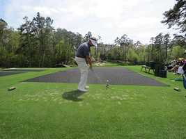West Des Moines amateur Mike McCoy tees off on Augusta National's famed 12th hole