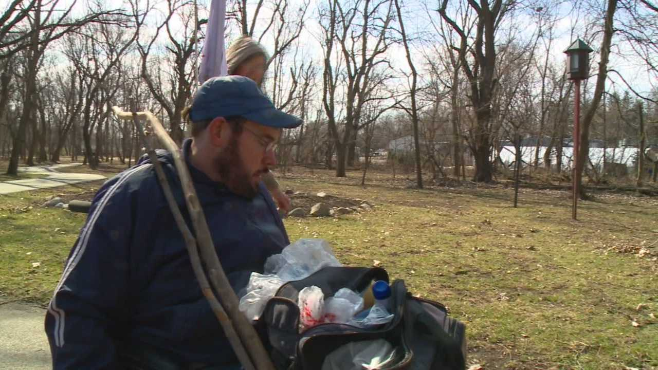 An Iowa man travels a popular bike trail picking up trash and spreading cheer.