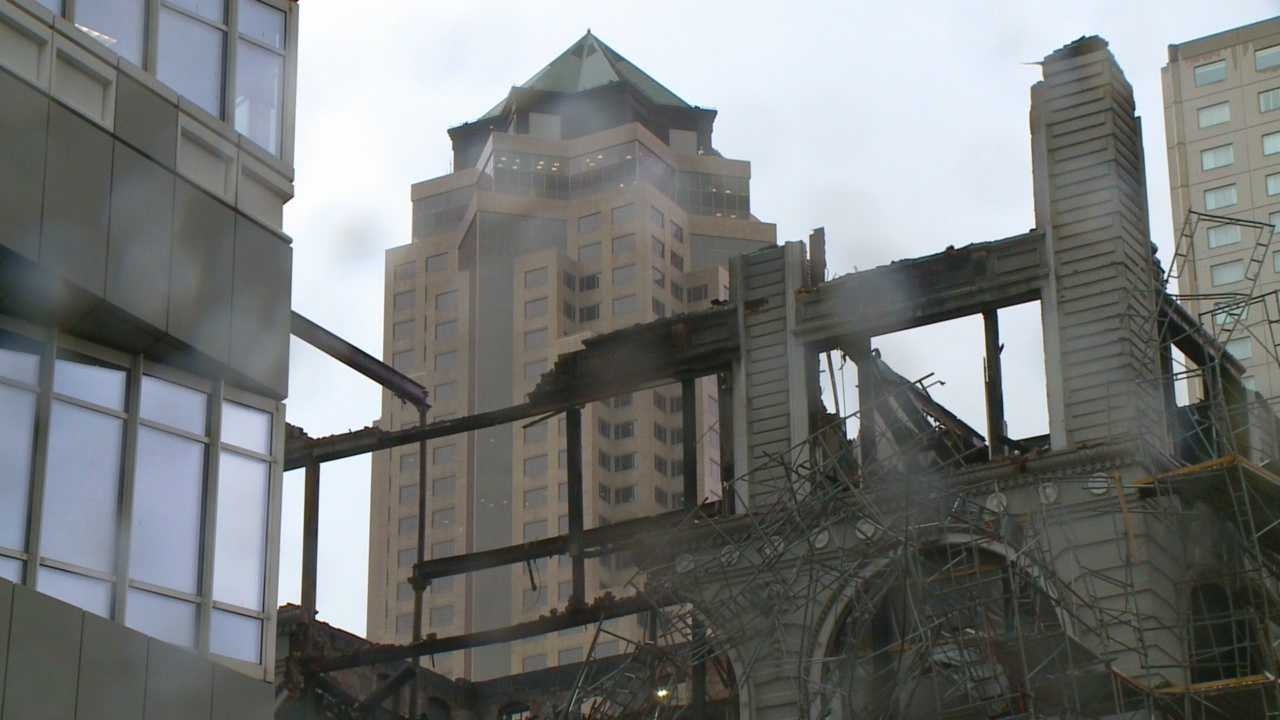 Rain and falling glass have delayed the demolition of the Younkers building's remains downtown.