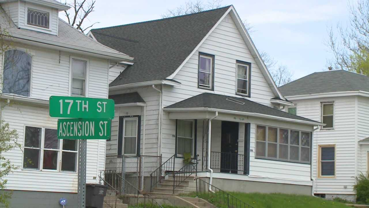 Two sisters were shot and injured outside a Des Moines home Sunday.