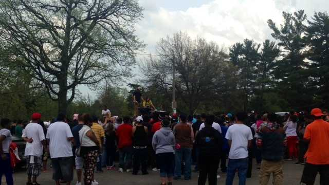 About 250 people showed up and brought pictures, candles, flowers and balloons to honor the 19-year-old.