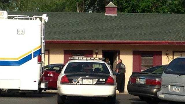 Police arrest a woman after the discovery of 36-year-old male in a Des Moines hotel.