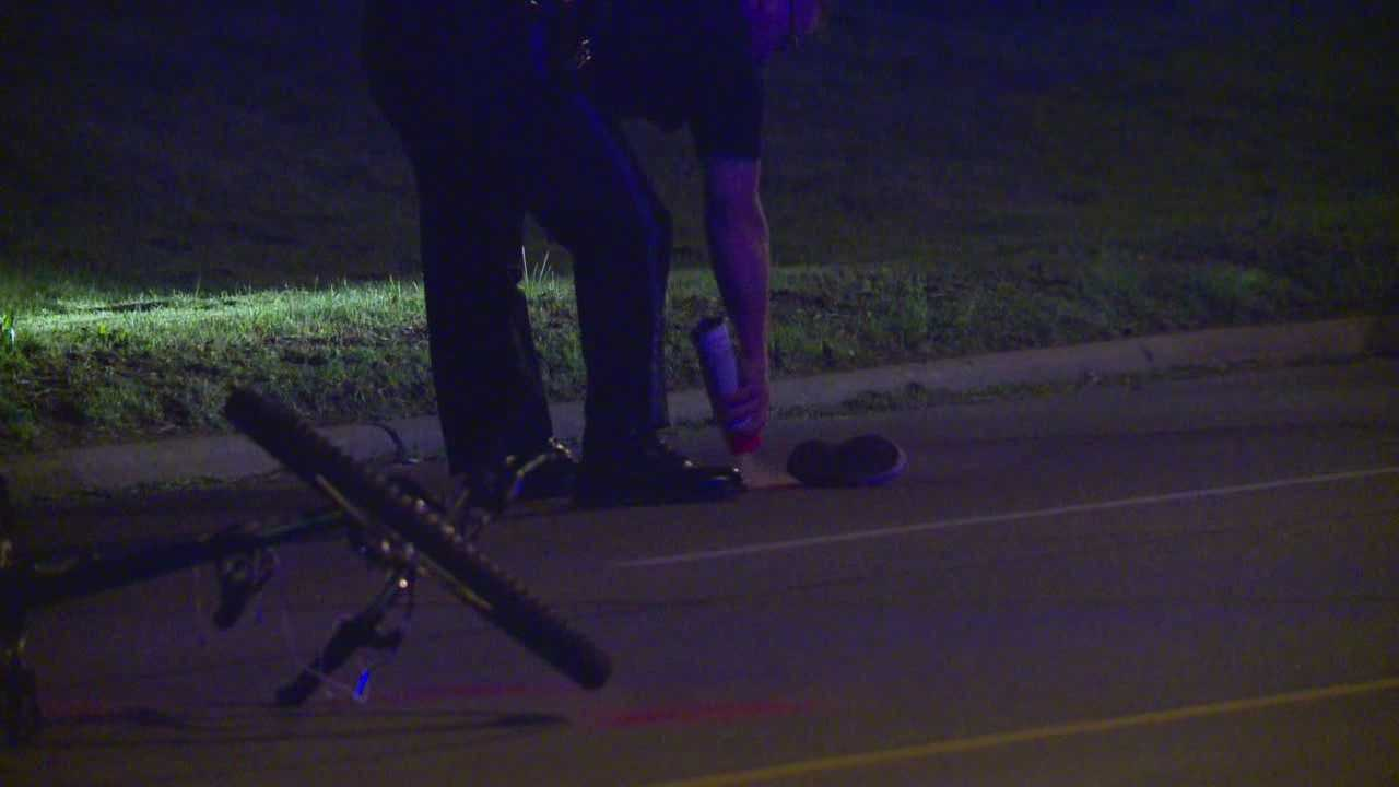 A bicyclist received minor injuries in a crash with a police officer early Thursday morning.