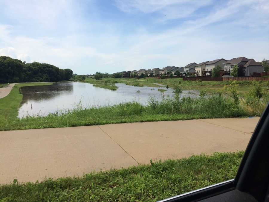Flooding at 156th and Douglas area, covering bike trails in Urbandale.