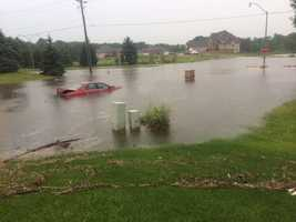 Cars trapped in flash flooding in Clive