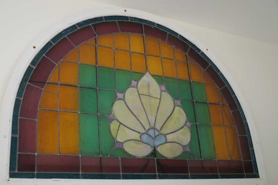 A stained glass window from the original church building.