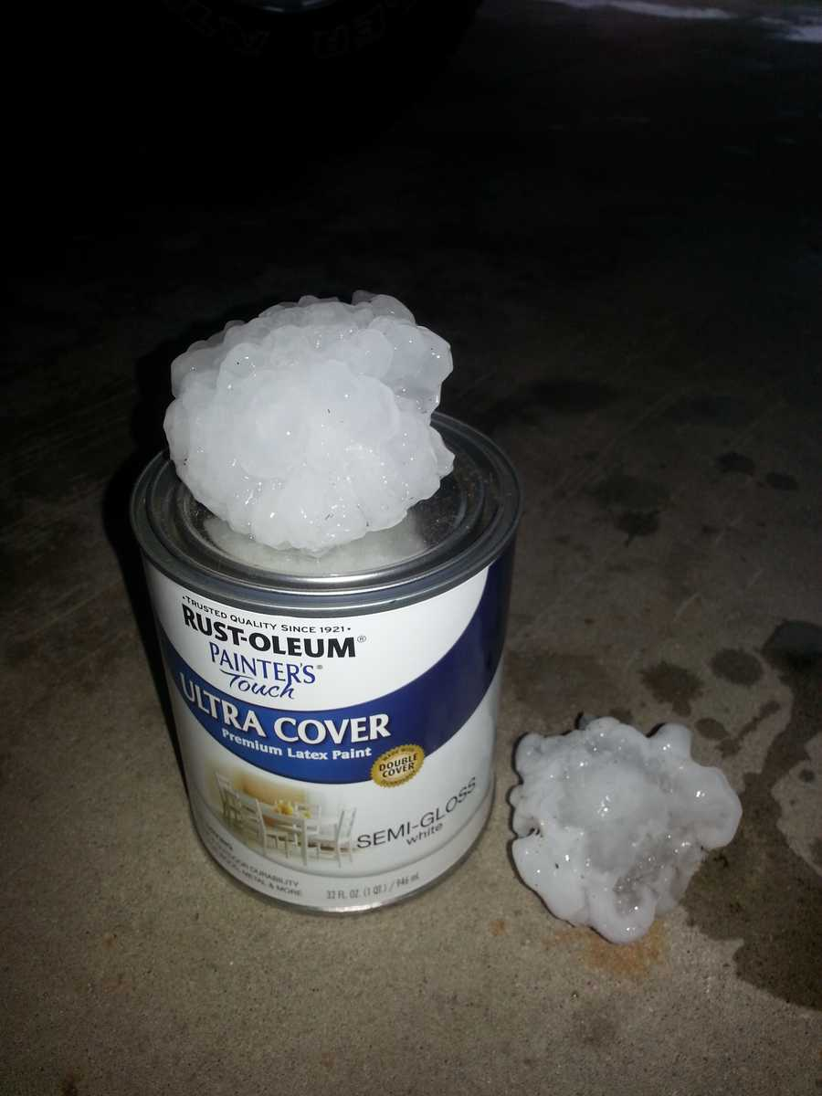 Large hail in Rockwell City this am. This picture was taken shortly after the storm moved thru. This is a 32oz. paint can. Wow. Sounded like bombs were hitting the roof