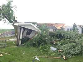 A home near Stuart hit by storm, possible tornado.