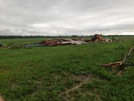 This leveled barn was storing an ATV and skid loader.