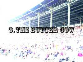 """3. The butter cow is back in the Ag Building, and this year's special butter creation is the """"Field of Dreams."""""""
