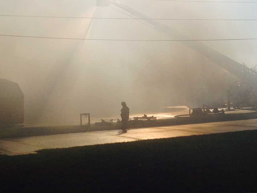 Eight fire crews tended to a fire that destroyed Farm and Home, a family-run business in Osceola, early Sunday.