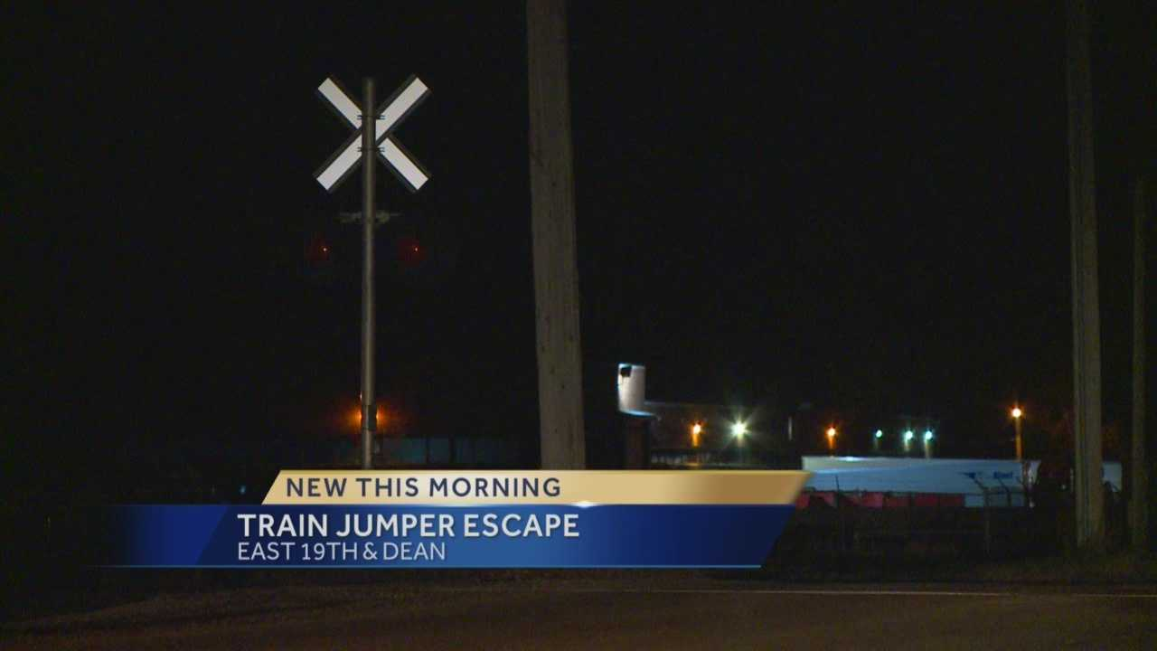 Des Moines police said a man is on the run after leading officers on a chase overnight and jumping on a train to escape.