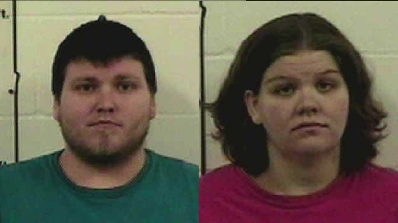 Two people are facing charges after police said they physically abused their newborn.