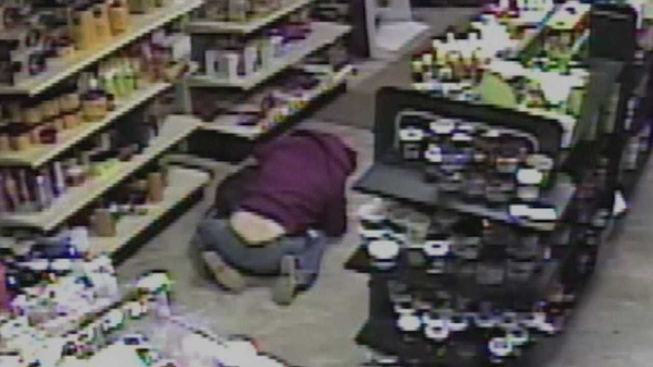 New surveillance video from an armed robbery last weekend shows how an act of heroism protected a 7-year-old.