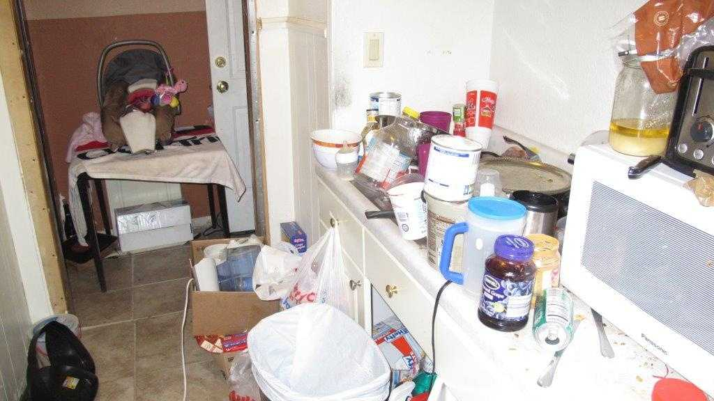 Police photos showing conditions inside the apartment.