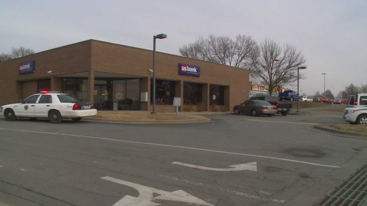 Customers at a Des Moines bank came to the rescue Friday after a man pulled out a gun and attempted to rob the bank.