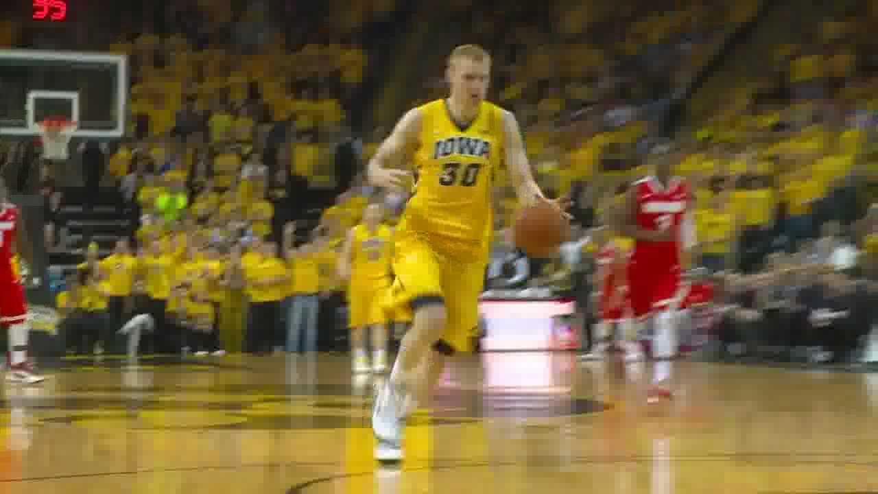 Aaron White scored 18 of his 22 points in the second half to lead Iowa to a 76-67 win over Ohio State on Saturday.
