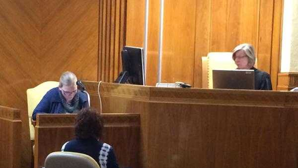 Leatha Slauson reads a letter to the court during her sentencing hearing.
