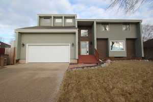 Beautiful two story 3 bedroom 2.5 bath has over 2600 sq. ft. of finish. Located in a desirable West Des Moines neighborhood near shopping, parks and trails. You are greeted with a two story foyer, warm formal living room and formal dining room. This leads you into the extensive kitchen that overlooks a second sunken living room with wet bar, vaulted ceilings and wet bar. This home is great for entertaining guests. Newer sliding glass doors leadout to a large deck that overlooks your private fenced in backyard. The master suite goes on for days with a built in powder area, 20' master closet, huge windows and vaulted ceilings with a master on suite.