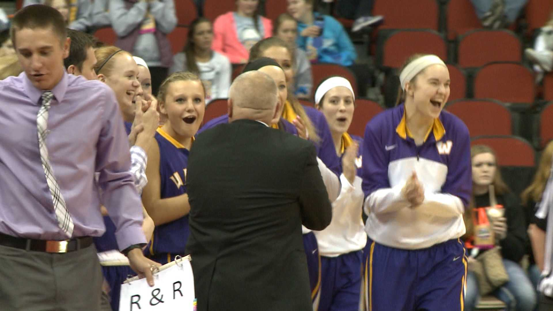 Waukee celebrates at the 2015 girls' state basketball tournament.