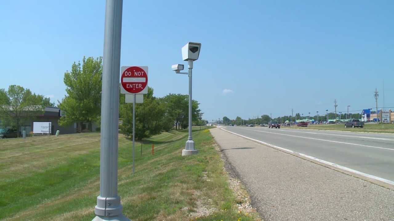 The City of Des Moines is facing a lawsuit over its red light and speed cameras.