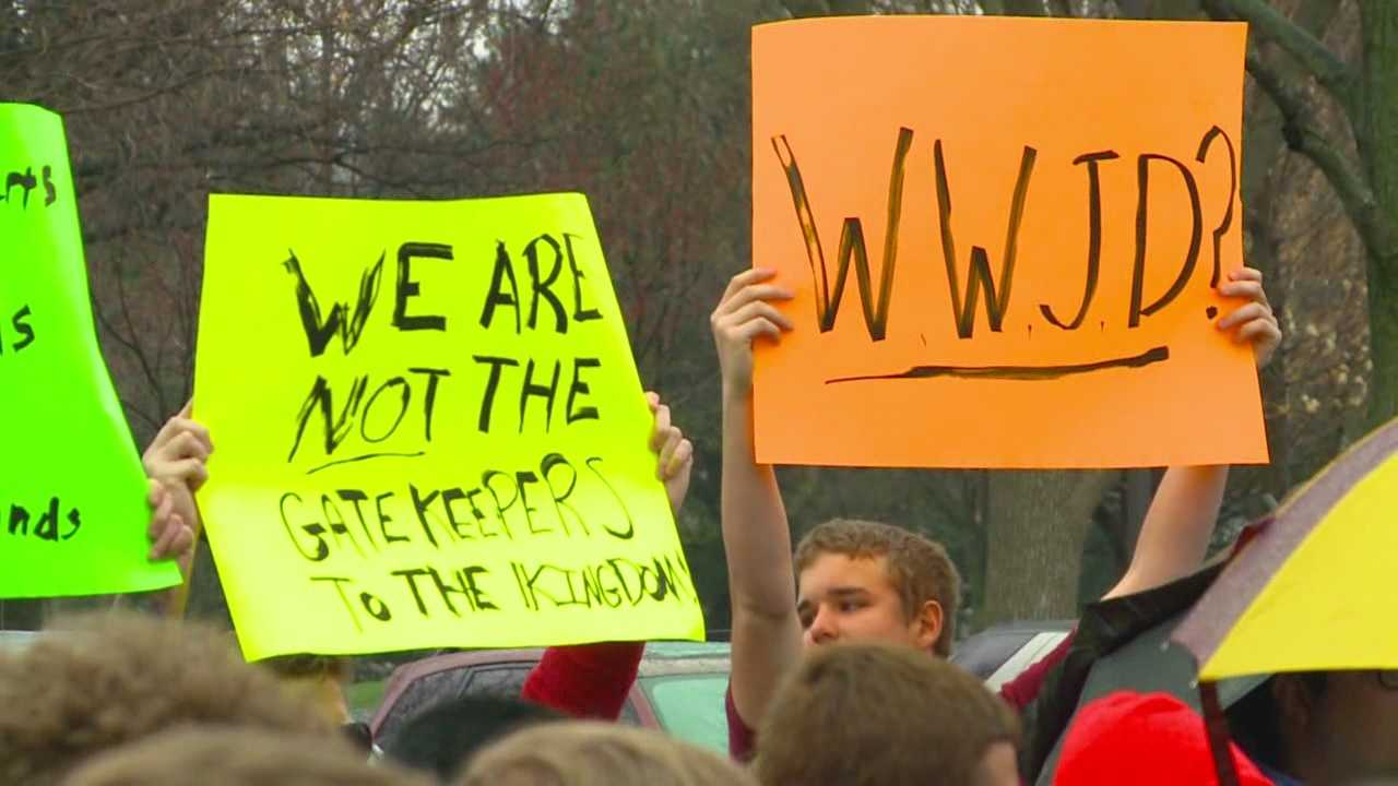 Students and alumni staged a walkout Wednesday in protest of a West Des Moines Catholic high school opting to not hire a substitute teacher full-time after learning he was gay.