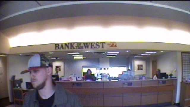 Photos released by police of a bank robbery in Des Moines.