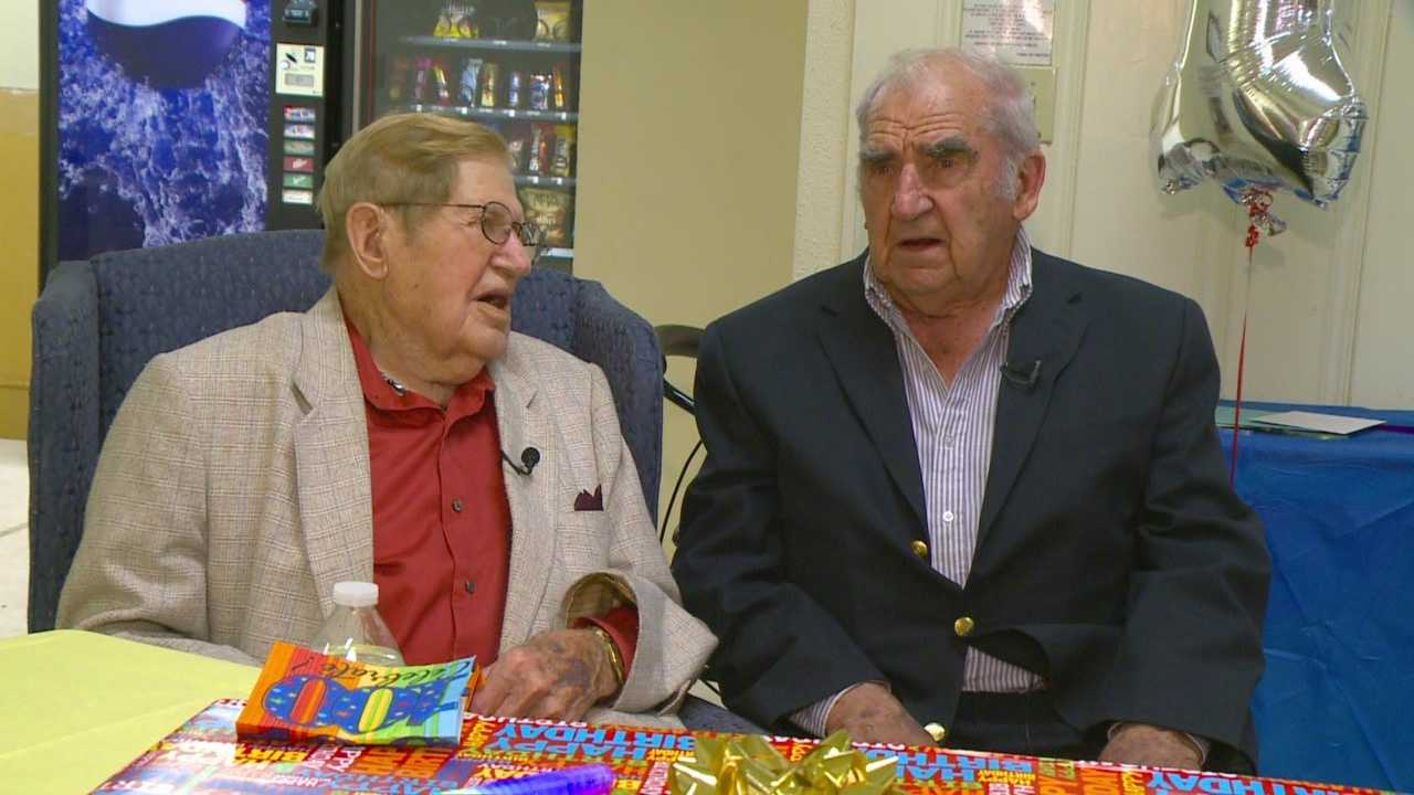 A Winterset man celebrated his 100th birthday with family and friends, including a man he met on the battlefields of World War II.