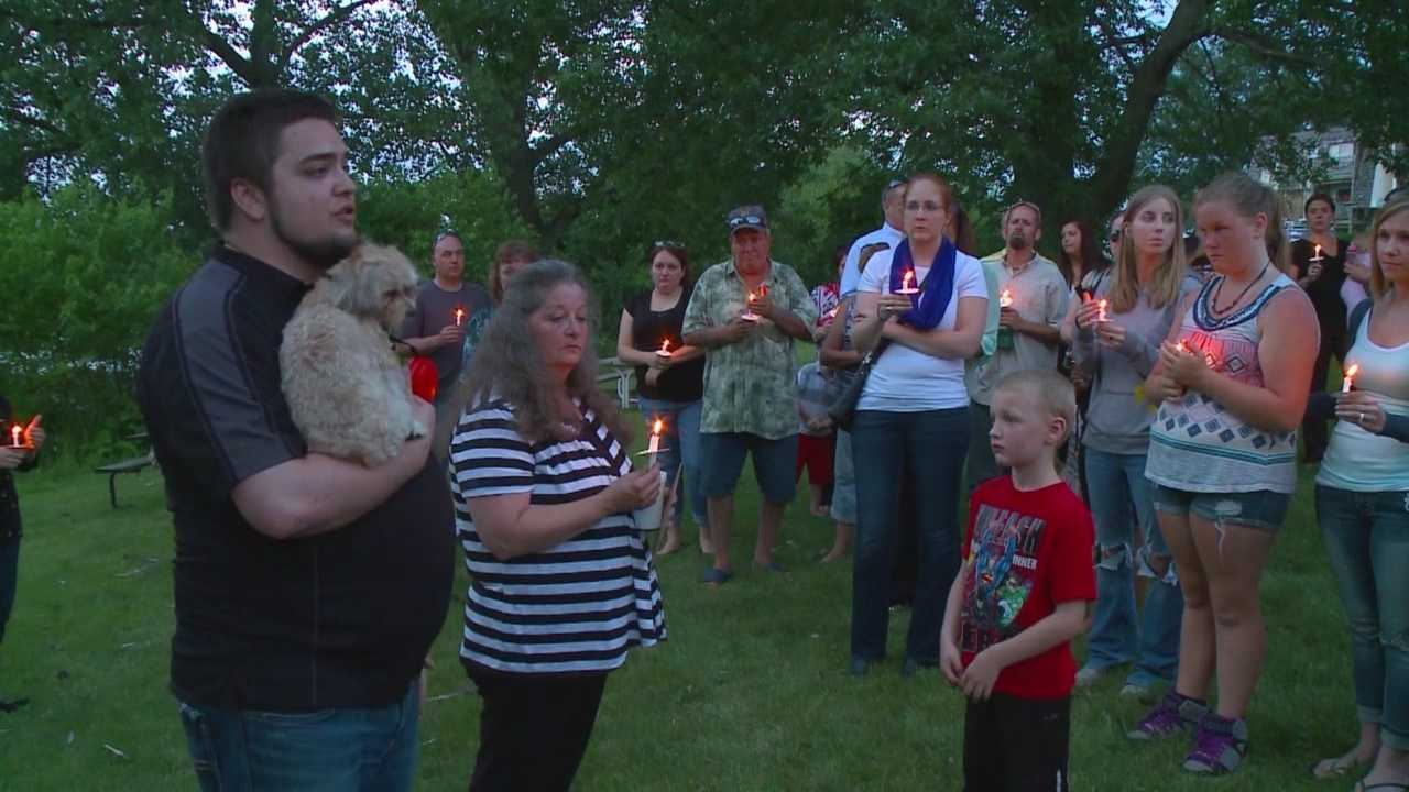 Dozens of people huddled together and held candles Tuesday night for Logan Habibovic.