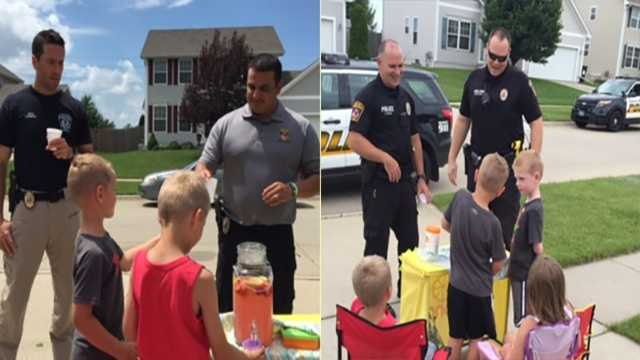 Ankeny police stop to support local lemonade stand.