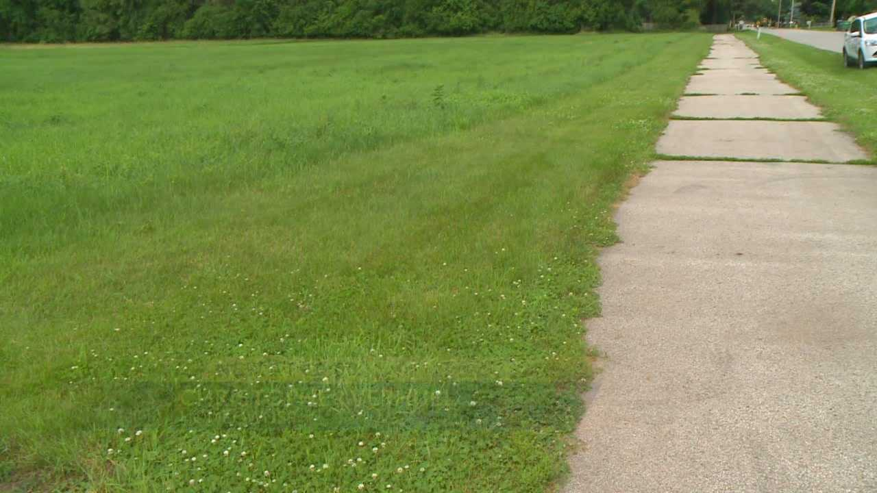 Johnston plans to move a bike trail across the street, taking more than 8 feet from a handful of property owners.