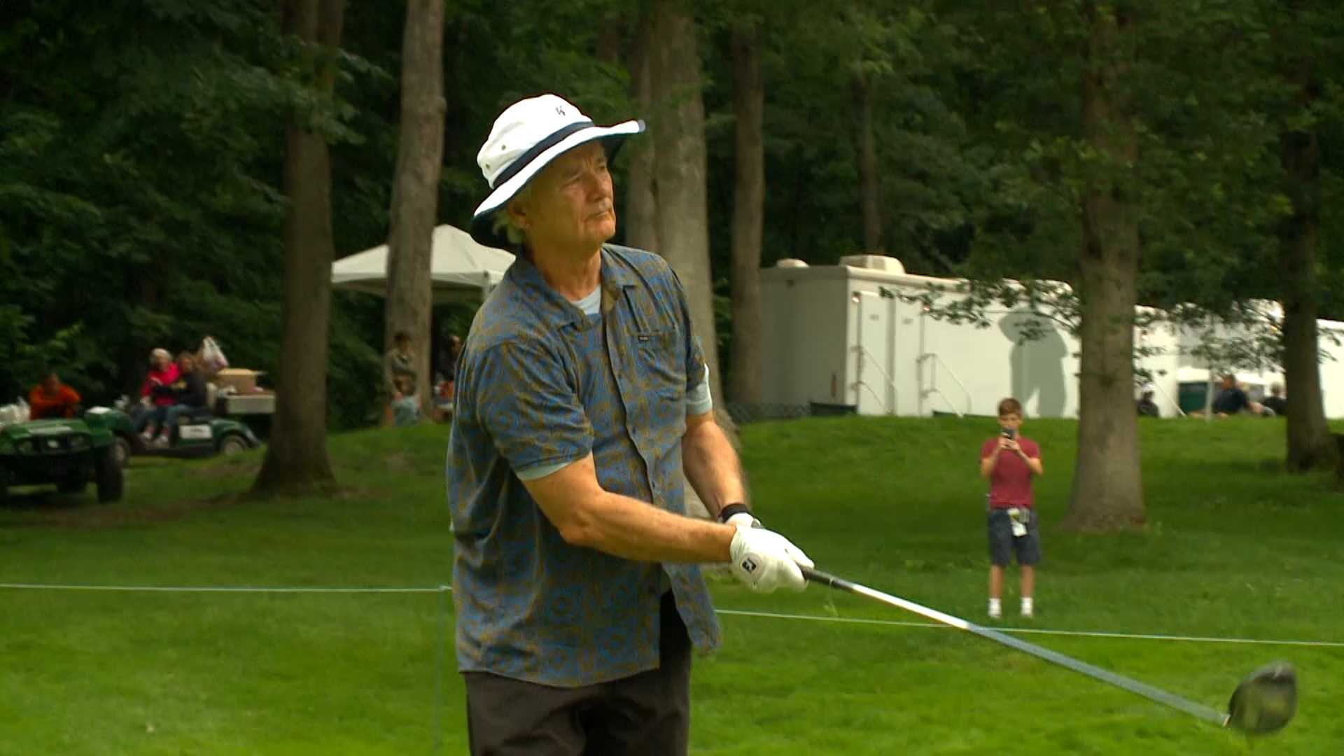 Comedian Bill Murray tees off during the Pro-Am at the John Deere Classic