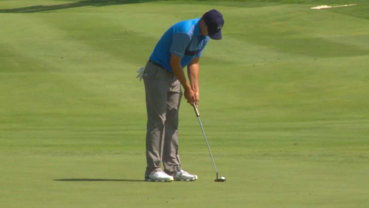 2013 John Deere Classic champion Jordan Spieth putts out during Thursday's first round.