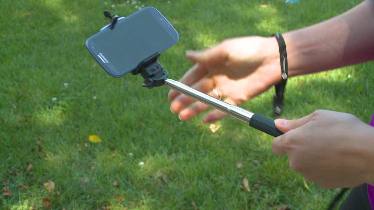 More amusement parks are banning selfie sticks.